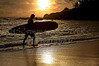 Hawaiian Island Surfer Emerges at Sunset