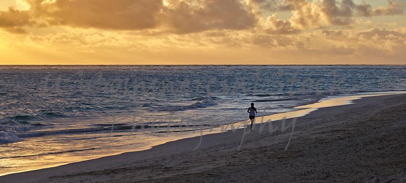 Ocean shorline runner at sunrise