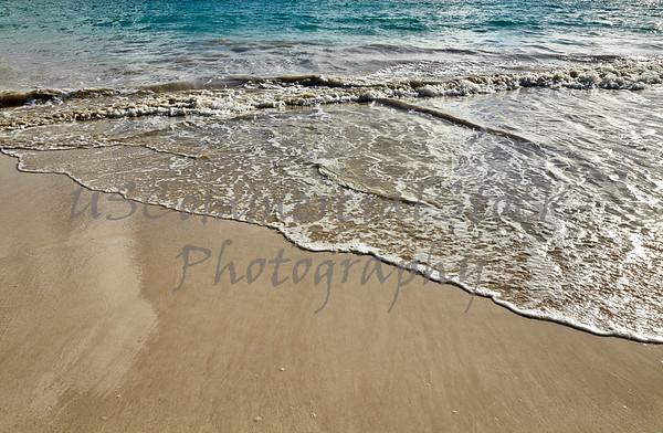 Exotic tropical island sandy beach shoreline closeup