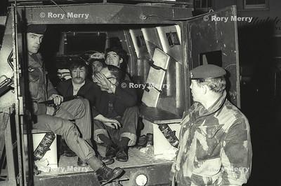 Northern Ireland Troubles Suspects under arrest by British Soldiers during night raid in Belfast Northern Ireland.
