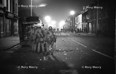 Northern Ireland night riot action. The British Army face off with the rioters on the streets of Belfast Northern ireland.