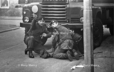 British Soldier lies on the ground having been wounded by a nail bomb during a riot in Belfast Northern Ireland.