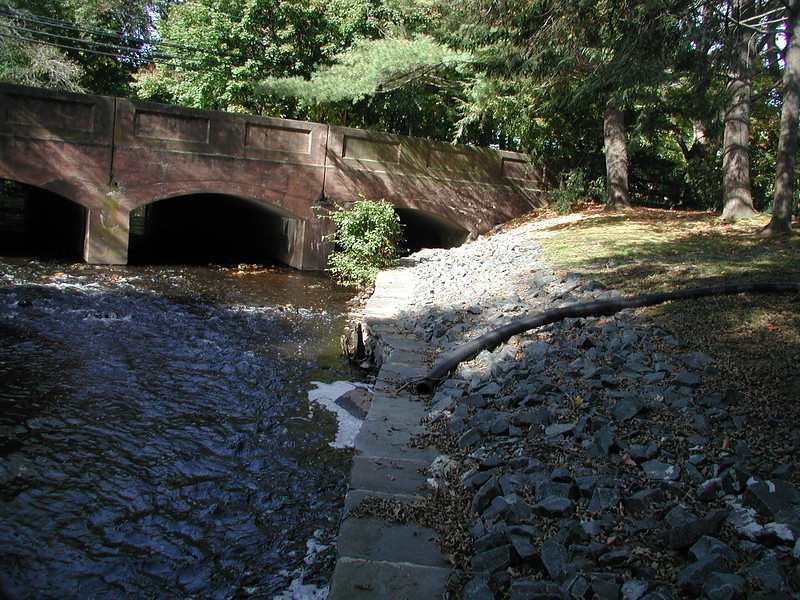 residential stormwater runoff plastic drain into Trout Brook channel downstream bridge at North Main Street