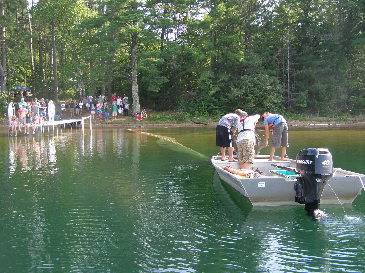 """The Fyke net pull, when researchers bring live fish up from the bottom of the lake, is always a popular """"spectator sport"""" at our open houses."""