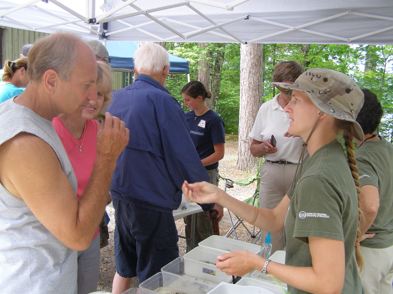 Carol Warden teaches a visitor the tricks of id'ing native aquatic plants. Here, the visitor is smelling the mustard-like fragrance of...