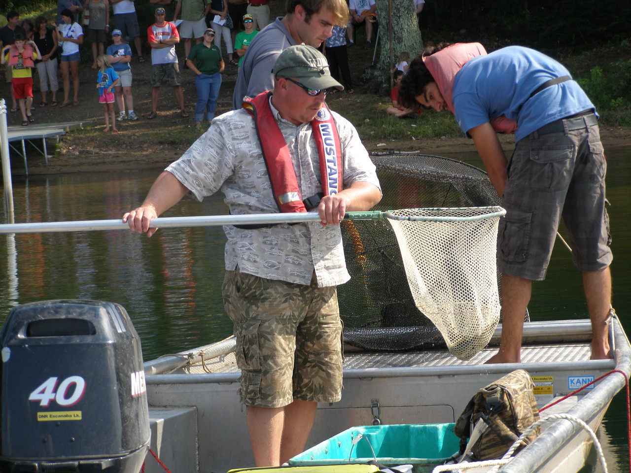 Greg Sass deposits one of the fish into a tub so folks on shore can get a closer look.