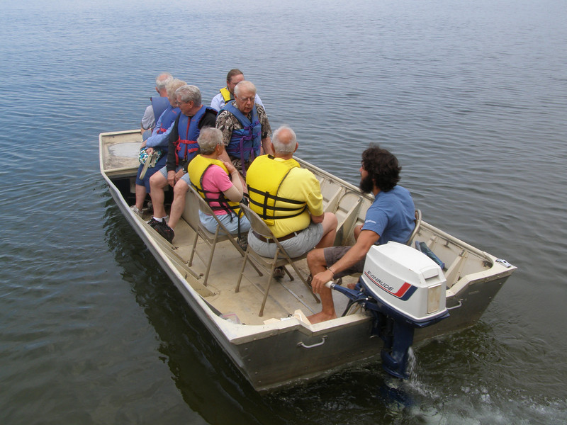 Like the Hasler Lab open house in Madison, visitors could take boat rides out on the lake to get first-hand experience using limnological tools. Unlike our big research vessel, the Limnos, Trout Lake visitors had to settle for aluminum folding chairs in an aluminum boat!