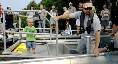 A little helper climbed aboard the electrofishing boat to help unload the haul from the fyke net