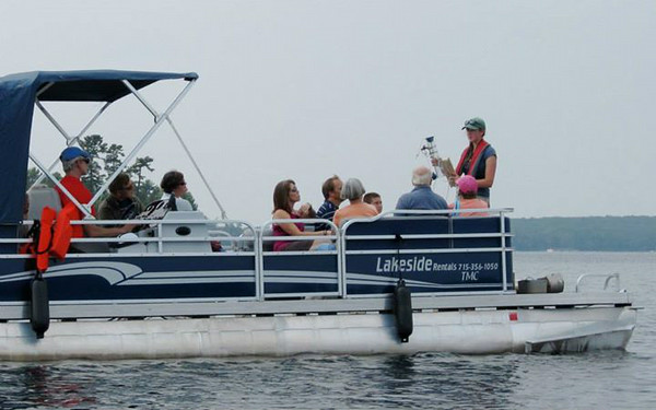 Undergraduate Ellen Albright explains how we sample lakes during a pontoon ride on Trout Lake