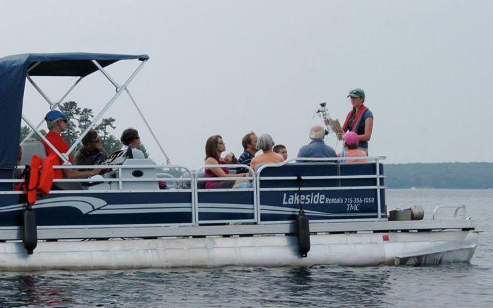 Undergraduate Ellen Albright explains how we sample lakes during a pontoon ride on Trout Lake