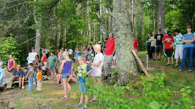 The crowd gathers to watch the fyke net pull