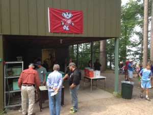 Visitors check out stations under the watchful eyes of Bucky at the Trout Lake open house.