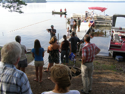 Trout Lake Station's summer director, John Havel, explains how a fyke net works as a crew prepares to haul one out of the lake.
