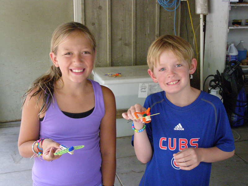 Maggie and Joe Masterson, who came with their grandmother, Nancy, show off the dragonflies they made at the craft station.