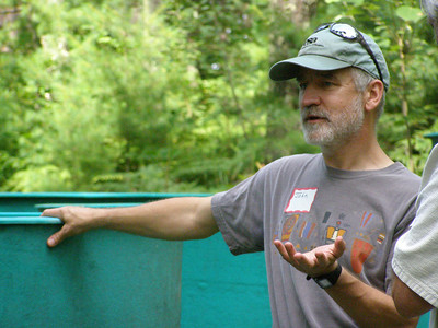 "Interim summer director, John Havel, speaks to a group about his ""air drying"" experiments on invasive species. In the course of running air tolerance experiments with invasive snails and plants, Havel, Susan Knight and a team of undergraduate students has found that some snails can survive being out of water for weeks."