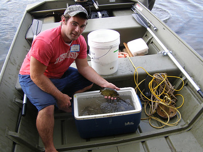 Station research technician, Zach Lawson, shows off part of the catch.