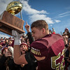 PORTLAND, MAINE -- 11/17/18 -- Thornton Academy's Ean Patry hoists the gold ball for the crowd to see at the Class A state football championship game in Portland on Saturday. Troy R. Bennett | BDN