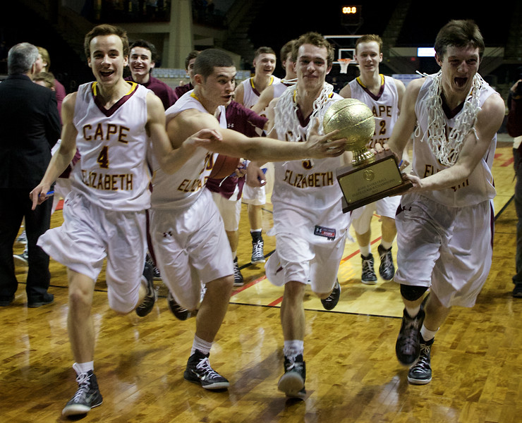 PORTLAND, MAINE -- 2/27/15 -- The Cape Elizabeth boys basketball team rushes off the court with the gold ball after defeating Medomak Valley High School 44-42 in the Class B State Championship game at Cross Insurance Arena in Portland Friday night. Troy R. Bennett   BDN