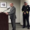 MARK ROBARGE -- MROBARGE@TROYRECORD.COM<br /> Troy Fire Department Chief Thomas Garrett, right, watches as Mayor Patrick Madden speaks during a ceremony to swear in four new firefighters and promote another Monday morning in City Hall.