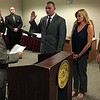 MARK ROBARGE -- MROBARGE@TROYRECORD.COM<br /> Mayor Patrick Madden, left, administers the oath of office to Troy Fire Department recruit Matthew Kent, standing with his parents, Susan and Matthew, during a ceremony Monday morning in City Hall.