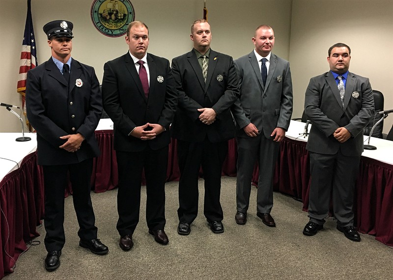 MARK ROBARGE -- MROBARGE@TROYRECORD.COM<br /> From left, Troy Fire Department Lt. Andrew Dolan and recruits David Coonrad, Adam Coonrad, Matthew Kent and Robert Jones pose for a group picture after a ceremony Monday morning in City Hall.