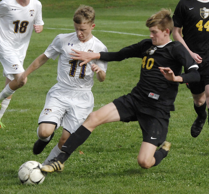 . STAN HUDY - SHUDY@DIGITALFIRSTMEDIA.COMBallston Spa sophomore center midfielder Ethan Cook leaps in front of Troy High\'s David Walczyk as he brings the ball up the sideline Wednesday afternoon.