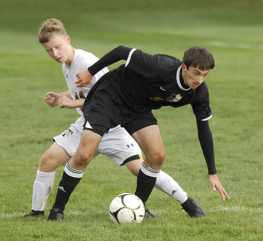 . STAN HUDY - SHUDY@DIGITALFIRSTMEDIA.COMBallston Spa junior Ian DeFilippis looks to regain his balance, playing up top for the first time in his career against Troy High\'s David Walczyk Wednesday afternoon.