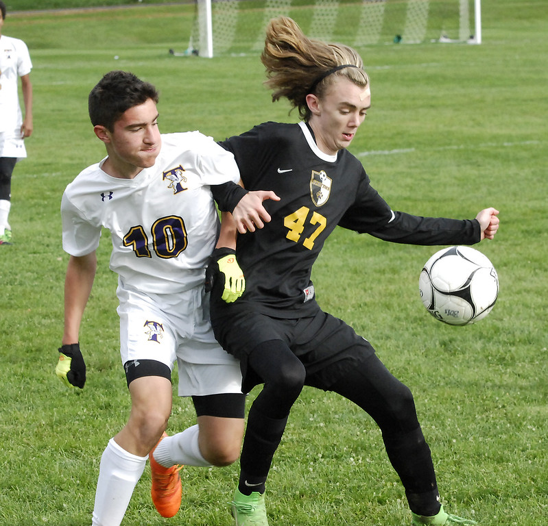 . STAN HUDY - SHUDY@DIGITALFIRSTMEDIA.COMTroy High\'s Xavier Schlemmer is tied up with Ballston Spa\'s Jeff Matthews in Wednesday\'s Section II playoff game at Ballston Spa.
