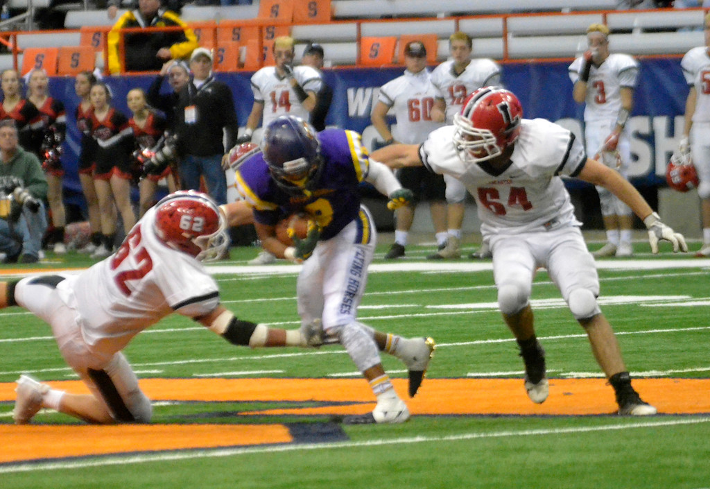 . David M. Johnson - djohnson@digitalfirstmedia.com  Troy\'s Dev Holmes returns a kickoff against Lancaster in the NYSPHSAA Class AA Championship Sunday at the Carrier Dome in Syracuse.