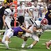 David M. Johnson - djohnson@digitalfirstmedia.com <br /> Troy High's Matt Ashley (10) tackles Lancaster's Andrew Hershey in the NYSPHSAA Class AA Championship Sunday at the Carrier Dome in Syracuse.