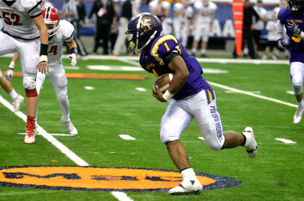 . David M. Johnson - djohnson@digitalfirstmedia.com  Troy High�s Joey Ward (1)runs the ball against Lancaster in the NYSPHSAA Class AA Championship Sunday at the Carrier Dome in Syracuse.