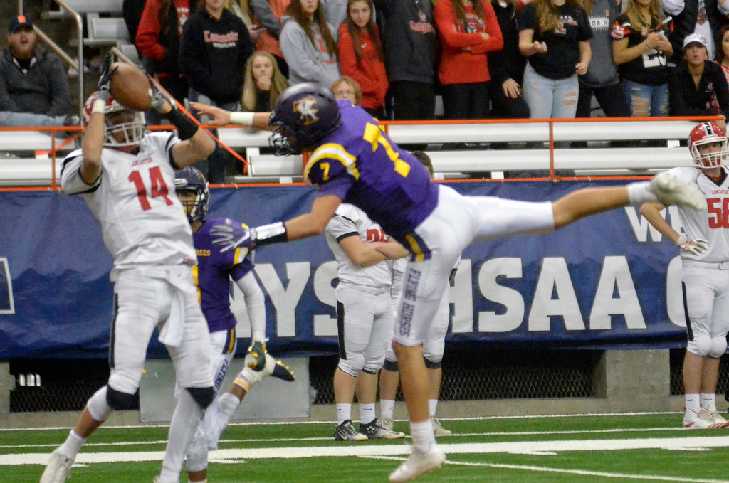 . David M. Johnson - djohnson@digitalfirstmedia.com  Lancaster\'s Max Giordano makes a catch over Troy\'s Joe Casale in the NYSPHSAA Class AA Championship Sunday at the Carrier Dome in Syracuse.