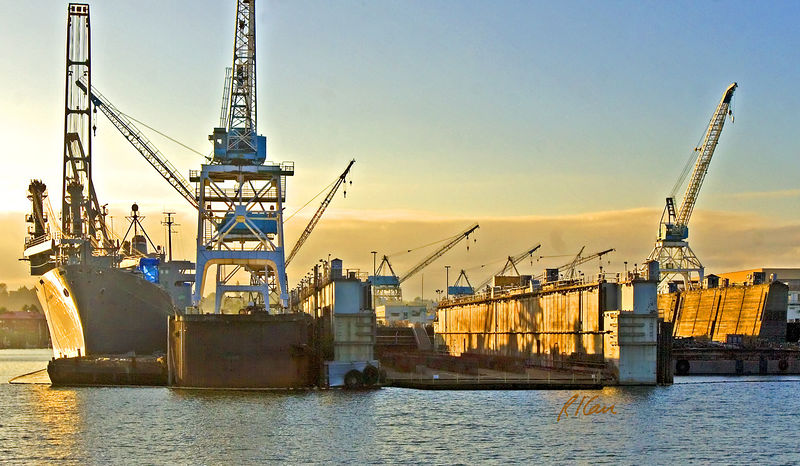 Marine transportation and construction: Dry dock at sunset, ready to receive ship for repair/refit. Port of Portland, Oregon, 2005.