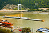 Boats/ships/barges: The Fluvius barge ship pushes two other barges under the Elizabeth Bridge headed upstream on the Danube River in Budapest, Hungary, July 2006.