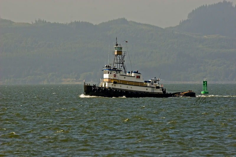 Marine transportation and construction: The tug boat James T. Quigg or Portland, Oregon towing a barge by cable on the lower Columbia River. 2005