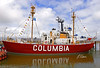 Lightship Columbia SLV604 exhibited at the Columbia River Maritime Museum. Served at the Columbia River Lightship Station, 5 miles west of the Columbia River's mouth in the Pacific Ocean, from 1951 until it was replaced by a large naval buoy. It is 128 ft long, 30 ft beam, 11 ft draft. Its illumination apparatus is a 1,200 watt light and an aircraft-type beacon with 13 mile range. Its foghorn has 5 mile range. Astoria, Oregon 2005.