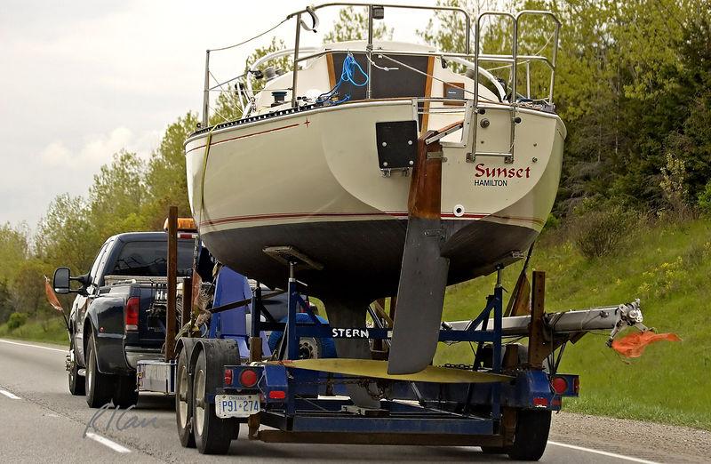 Towing trailer, sailboat: Towing deep keel sailboat on highway. Ontario 2005.