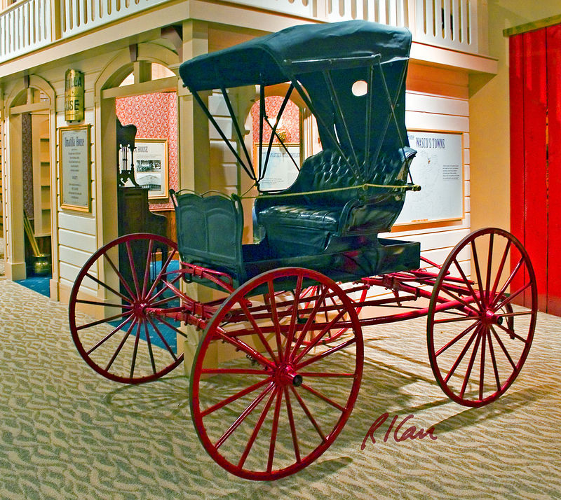 carriage: Four wheel, horse drawn leaf spring supported, folding roof, single seat phaeton carriage. Columbia Gorge Discovery Center, The Dalles, Oregon 2005.