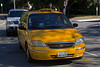 Taxi cab: Yellow Cab Ford Freestar van taxi cab driving to pick up passenger. Los Angeles, CA 2004.