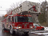 Fire engine: Ann Arbor Fire Department ladder truck T-1 responding to an emergency in a December snow storm. Ann Arbor, Michigan2004