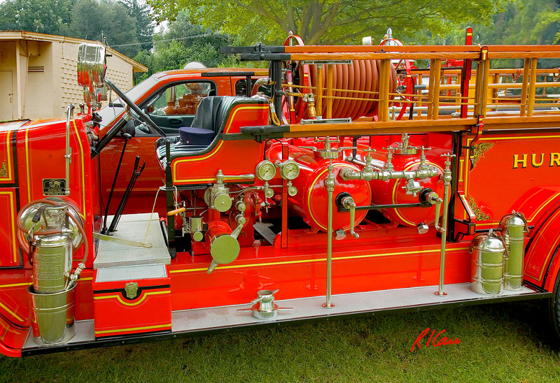Fire engines, trucks, apparatus, historical: 1925 Larrabee/Buffalo chemical fire truck, formerly of Huron Fire Department, Ohio, showing chemical tanks and valves at about midlength of truck. Fire apparatus Muster, Riverside Park, Ypsilanti, Michigan August 26, 2006