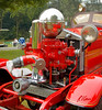 Fire engines, trucks, apparatus, historical: Piston water pump on 1931 Ahrens-Fox pumper. The chrome sphere is an air pressure tank that evens out water pressure in hoses during piston pump cycles. Fire apparatus Muster, Riverside Park, Ypsilanti, Michigan August 26, 2006
