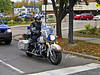 Motorcycle Policeman: Ann Arbor Police Officer on motorcycle patrol in front of Ann Arbor City Hall and Police Station. Ann Arbor, Michigan, 2004