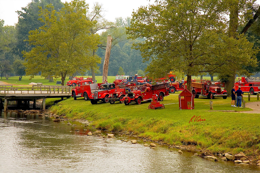 Fire engines, trucks, apparatus, historical: A portion of the fire apparatus at the Muster on the bank of the Huron River, Riverside Park, Ypsilanti, Michigan August 26, 2006