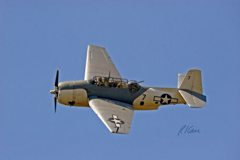 "Vintage military, war planes: Grumman TBM-3E Avenger torpedo bomber N9584Z ""Ida Red"". The Avenger's first action was at the Battle of Midway, June 1942. Propellor driven by single Wright R-2600-20 radial piston engine, it had range of 1000 miles and speed of 276 mph. It carried bombs up to 2,000 lb and was armed with three 12.7 mm and one 7.62 mm machine gun. Thunder Over Michigan, Willow Run Airport, Ypsilanti, Michigan 2005."
