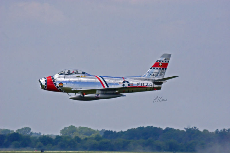 Vintage military aircraft: F-86 Saber Jet performing in air show. Thunder Over Michigan, Yankee Air Force, Willow Run Airport, Ypsilanti, Michigan, August 2005.