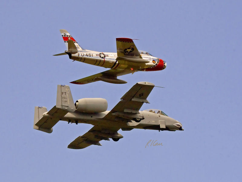 Vintage military aircraft: A-10 Warthog and F-86 Saber Jet flying in formation in air show. Thunder Over Michigan, Yankee Air Force, Willow Run Airport, Ypsilanti, Michigan, August 2005.