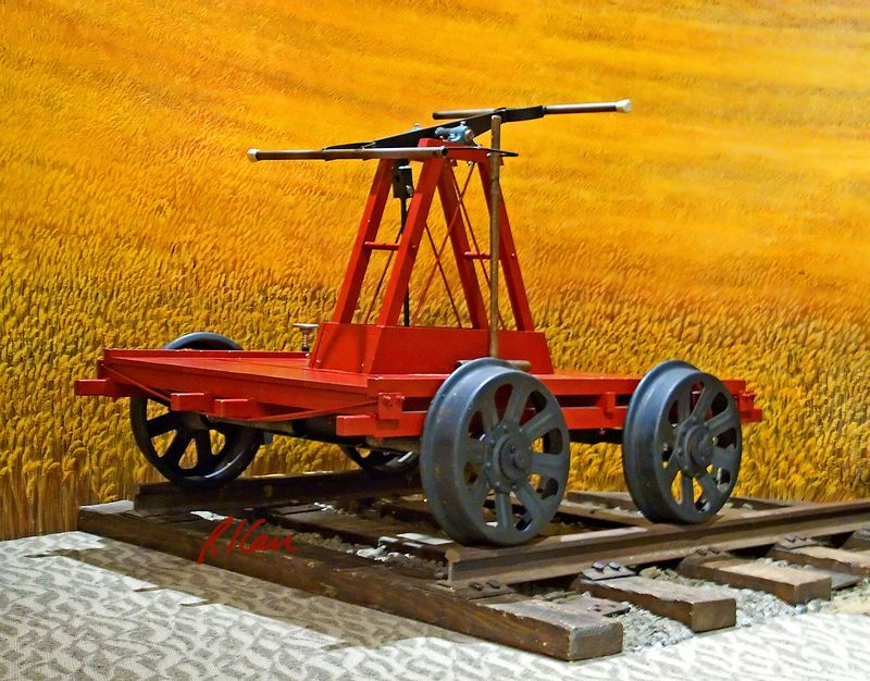 Railroad construction/ maintenance: Rairoad hand car used by 1 to 4 people to propell themselves along rails to inspect and repair small problems. Columbia Gorge Discovery Center, The Dalles, Oregon, 2005.