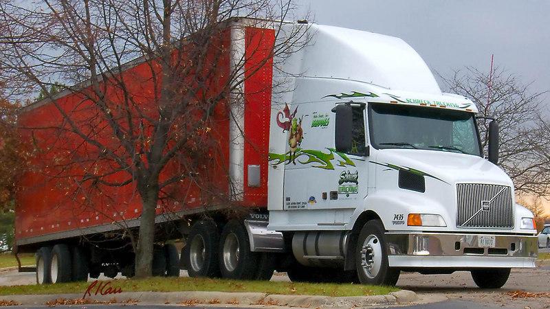 Volvo tractor pulling semi-trailer, at overnight stop. November 2006, Ann Arbor, Michigan.
