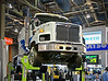 Concrete/masonry construction: New International Paystar concrete mixer truck, elevated so audience can view undercarriage. The truck features a lighter weight that allows it to legally haul more concrete. Weight reduction comes from lighter frame and introduction of Cummins ISL 350 hp engine and McNeilus Revolution Barrel.  World of Concrete/Masonry, Las Vegas, Nevada January 2006
